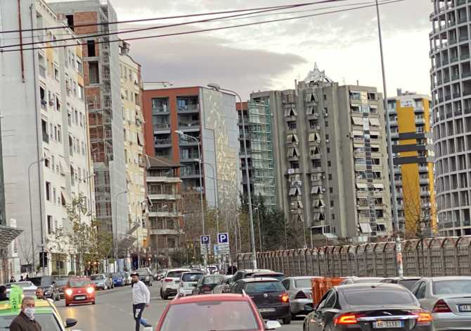 """The house is located in Tirana the """"Blloku/Liqeni Artificial"""" area and"""